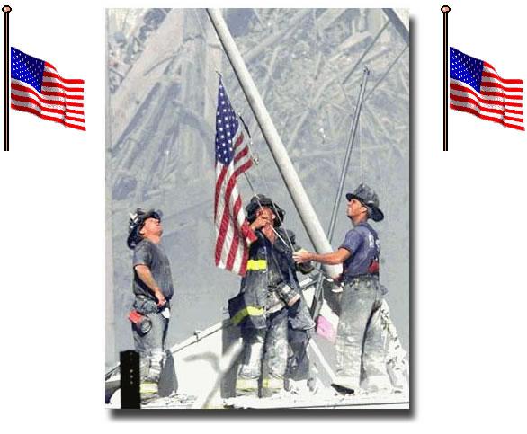 Firemen handling an American Flag