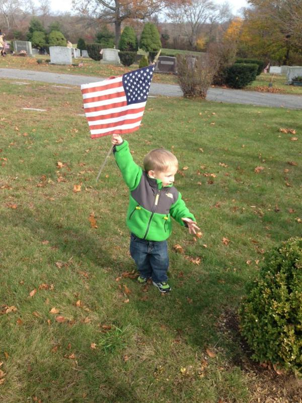 Baby holding american flag