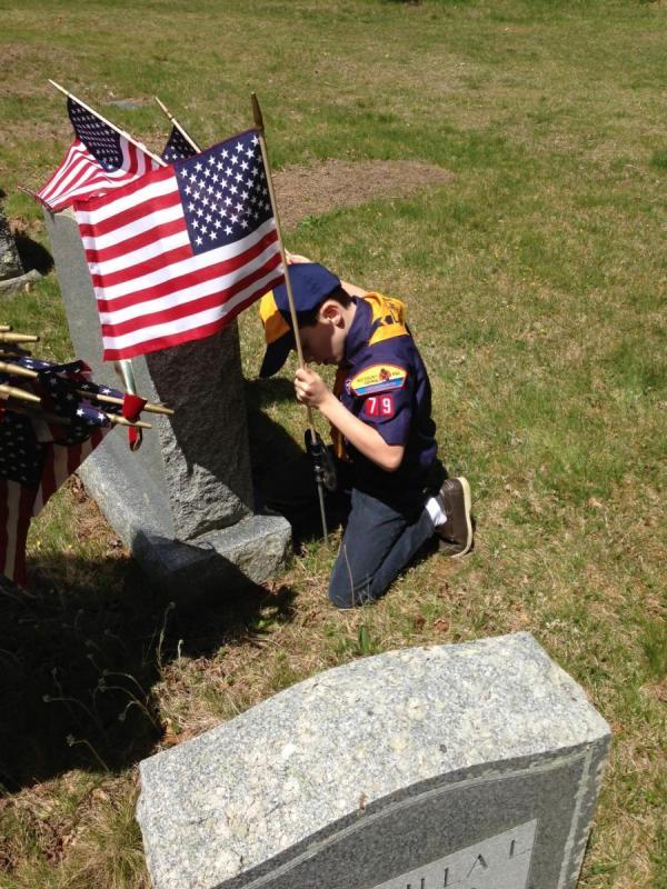 Placing flags in Marshfield Cemeteries