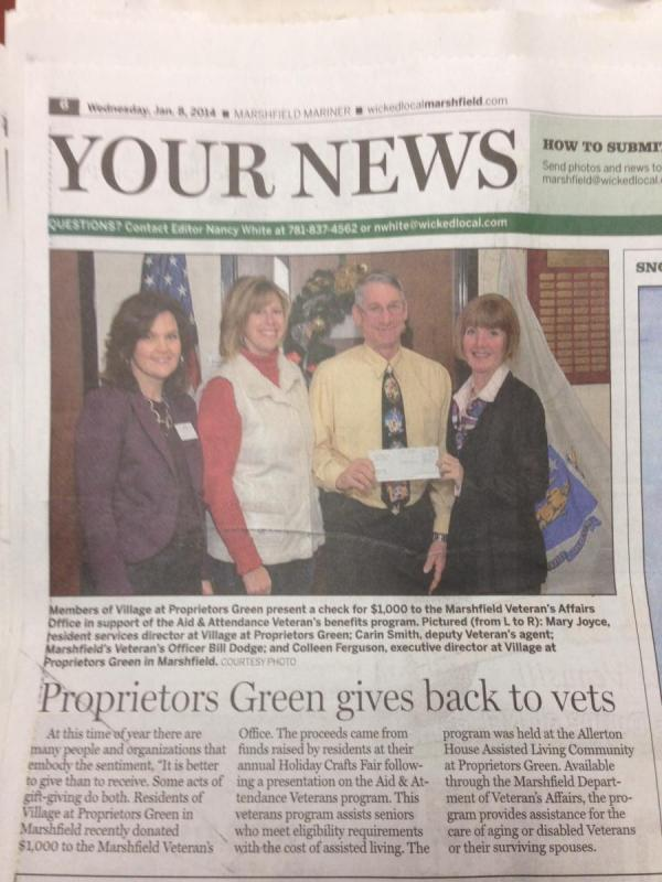 Colleen Furguson of Proprietors Green presents Veterans' Services Officer Bill Dodge a donation check for Veterans
