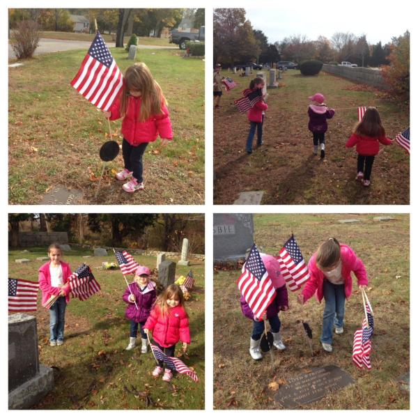 Placing flags at Marshfield Cemeteries in honor of Veterans' Day